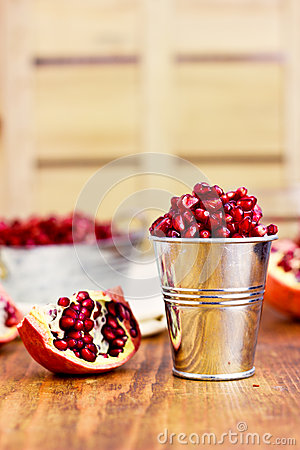 Free Pomegranate Seeds In A Metal Bucket On The Wooden Background Royalty Free Stock Photography - 40963377