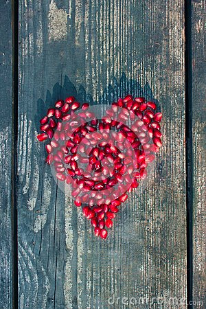 Free Pomegranate Seeds In Heart Shape Royalty Free Stock Photography - 49772807