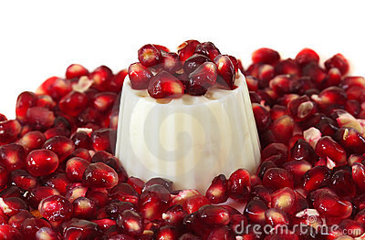 Pomegranate seeds with a white fresh cheese