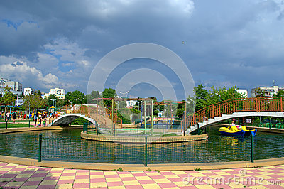 Pond in а park and storm clouds Editorial Photo