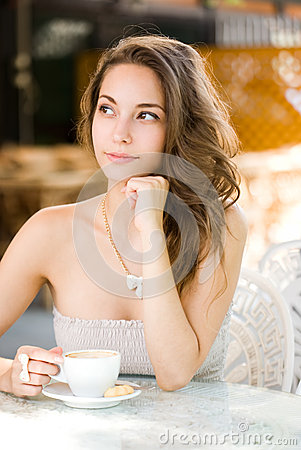 Pondering coffee brunette.