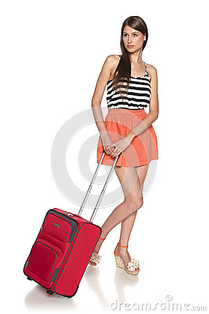 Pondering female with suitcase