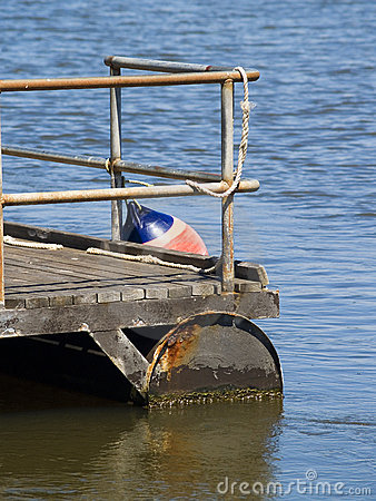 Pontoon with steel railings and bouy