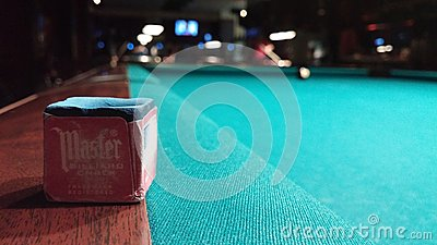 Pool chalk on green wooden table