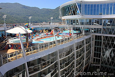 Pool deck and Viking Crown Bar onboard Oasis Editorial Photo