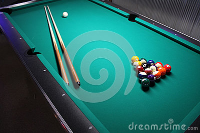 A Pool Table, set-up for a game.