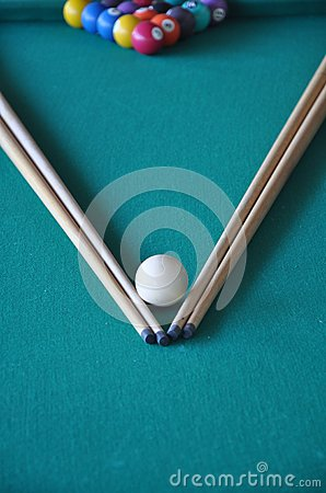 pool sticks and balls
