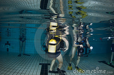 Pool underwater with scuba divers