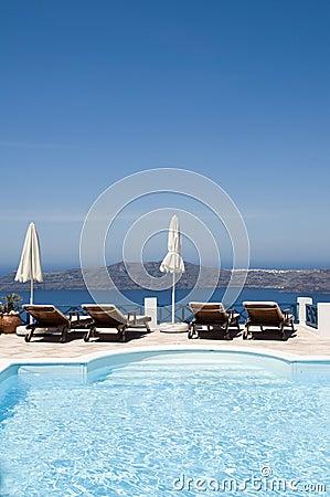 pool view of volcanic island  santorini
