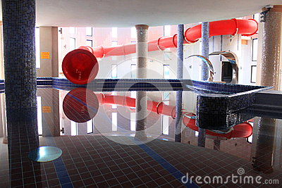 Pool and red water slide