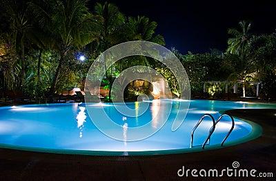Pool and waterfall at night