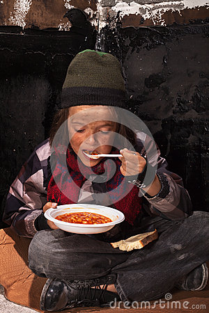 Free Poor Beggar Child Eating Charity Food Royalty Free Stock Images - 31587119