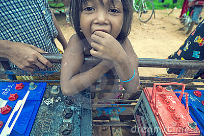 Poor cambodian kid playing Editorial Photography