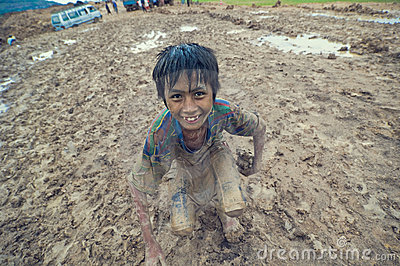 Poor cambodian kid playing Editorial Image