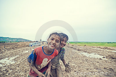 Poor cambodian kid playing Editorial Photo