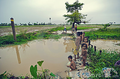 Poor cambodian kids. Fishing scene on Tonle Sap Editorial Stock Photo