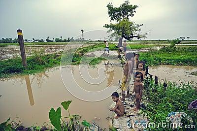 Poor cambodian kids. Fishing scene on Tonle Sap Editorial Stock Photo