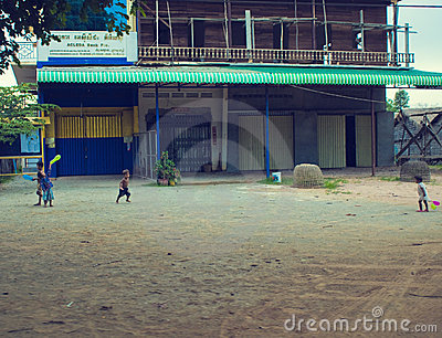 Poor cambodian kids playing near a new house. Editorial Stock Photo