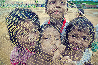 Poor cambodian kids playing with trawl Editorial Stock Photo