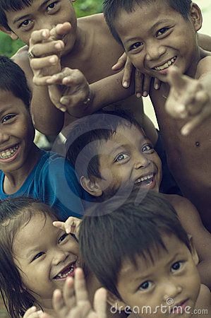 Poor cambodian kids smiling and playing Editorial Photography