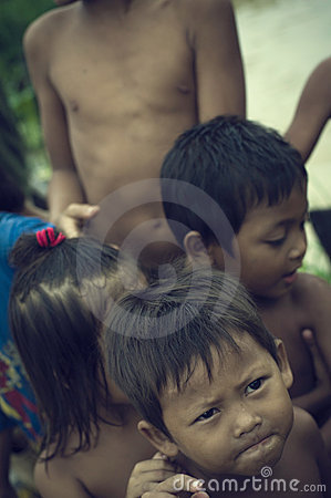 Poor cambodian kids smiling or playing Editorial Stock Image