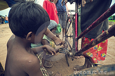 Poor cambodian kids working Editorial Photo