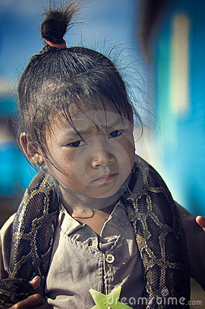 Poor children and snake from Cambodia Editorial Stock Photo