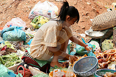 Poor girl selling food Editorial Image