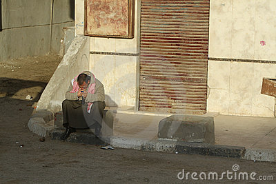 Poor man with cell phone in Cairo, Egypt Editorial Image
