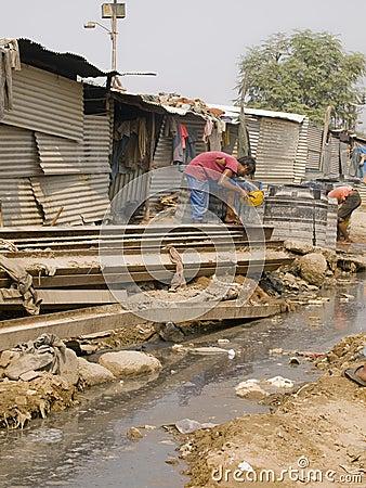 Poor man in the slums in India Editorial Image