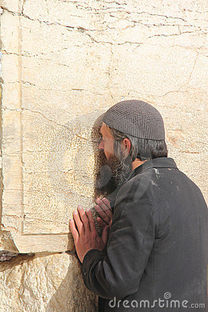 Poor man at the Wailing Wall Editorial Stock Image