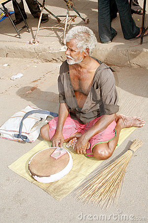 indian beggar with credit card machine