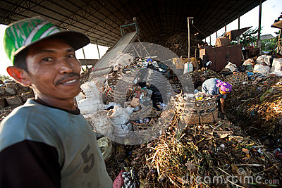 Poor people working in a scavenging at the dump Editorial Stock Photo