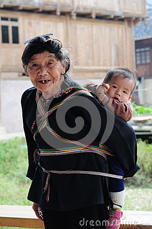 Free Poor Traditional Lady Who Care Kid In The Old Village In China Stock Photo - 32856610