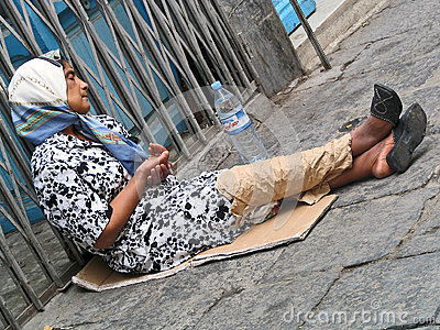 Poor woman begging for money on the street Editorial Stock Photo
