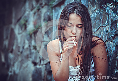 Poor young woman with a cigarette