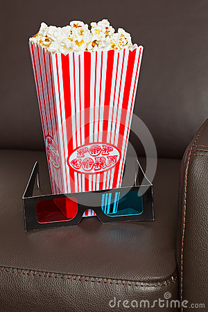 Popcorn 3D glasses and cinema chair.