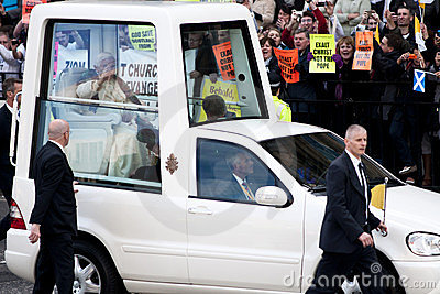 Pope Benedict XVI and protesters Editorial Photo