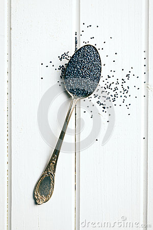 Poppy seed in silver spoon