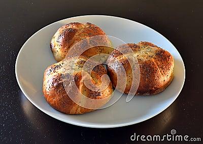 Poppy seeds shortbread cakes on white plate