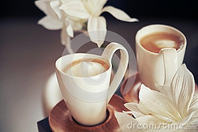 Porcelain cups with coffee