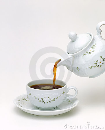Porcelain teapot pouring tea