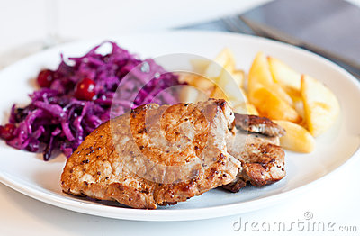 Pork chop with cabbage salad and potatoes