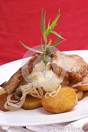 pork chop, sauerkraut and roasted potato