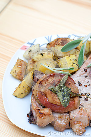 Pork chops with apples and oven roasted potatoes