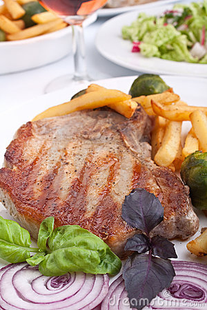 Pork chops with fries and brussels sprouts