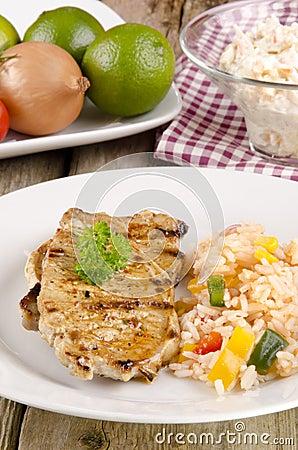 Pork chops with rice salad