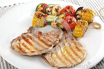 Pork chops with vegetables brochette