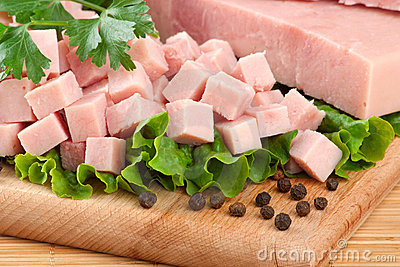 Pork  ham arranged on cutting board with parsley a