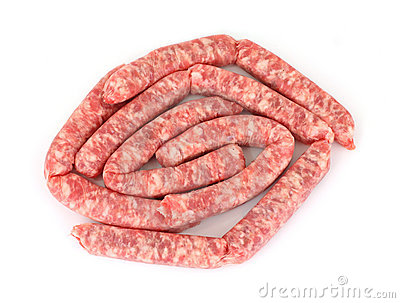 An overhead view of fresh ground pork link sausages.